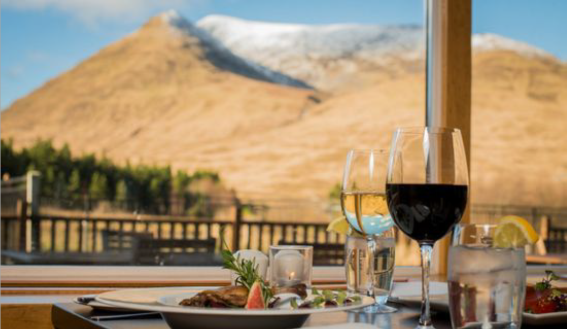 Table with wine and mountain